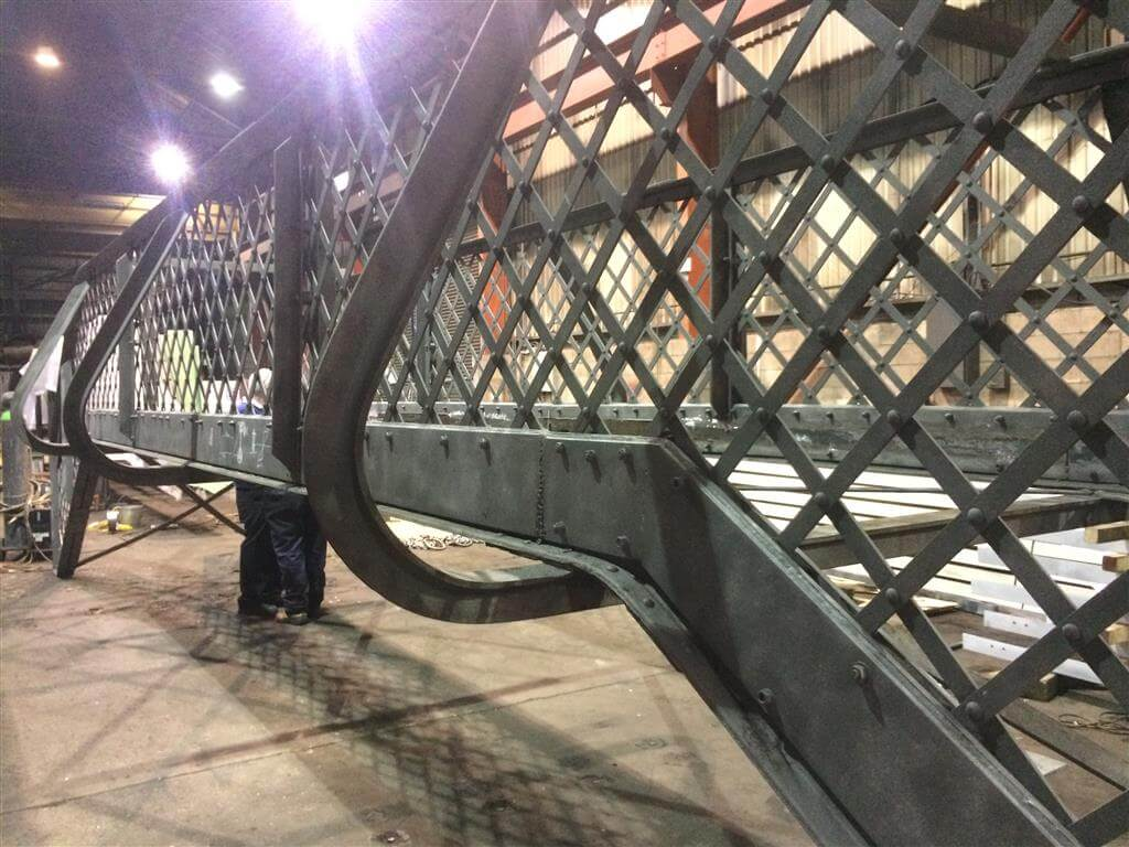 Refurbishment design and specification, including the remediation of defective structural members, for a lattice girder passenger footbridge.